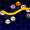 Halloween Couples - Draw a line with your mouse making a path on the hexagons to connect two or more Halloween symbols of the same kind.